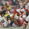 Photo - Washington Redskins quarterback Robert Griffin III is sacked by Kansas City Chiefs outside linebacker Tamba Hali during the first half of an NFL football game in Landover, Md., Sunday, Dec. 8, 2013. (AP Photo/Pablo Martinez Monsivais)