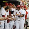 Photo - St. Louis Cardinals' Jhonny Peralta is congratulated by teammates after his two-run home run against the San Diego Padres' in the second inning in a baseball game, Thursday, August 14, 2014, at Busch Stadium in St. Louis. (AP Photo/Bill Boyce)
