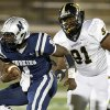 Edmond North\'s Michael Farmer runs past Midwest City\'s Brandon Jones on his way to a touchdown during a high school football game at Wantland Stadium in Edmond, Thursday, October 25, 2012. Photo by Bryan Terry, The Oklahoman