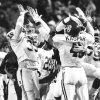 The OU defense celebrates after stopping OSU\'s last drive in the 1988 Bedlam college football game. Staff photo by Paul Hellstern