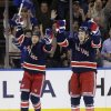 New York Rangers\' Derek Stepan, right, celebrates his goal with Ryane Clowe during the first period of an NHL hockey game against the New Jersey Devils, Sunday, April 21, 2013, in New York. (AP Photo/Seth Wenig)