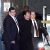 In this Nov. 21, 2012 photo provided by VosIzNeias.com, police escort Salvatore Perrone, center, from New York\'s the 67th Precinct. Perrone, a New York City garment salesman accused of systematically shooting three Middle Eastern shopkeepers to death, was taken into custody Wednesday in the suspected serial killings. A pharmacy worker recognized Perrone, 63, as the balding man shown in surveillance footage leaving the scene of the most recent shooting on Nov. 16, police said. (AP Photo/VosIzNeias.com, Shimon Gifter)