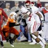 BEDLAM: Oklahoma\'s DeMarco Murray (7) gets running room past Oklahoma State\'s Ricky Price (6) during the first half of the college football game between the University of Oklahoma Sooners (OU) and Oklahoma State University Cowboys (OSU) at Boone Pickens Stadium on Saturday, Nov. 29, 2008, in Stillwater, Okla. STAFF PHOTO BY CHRIS LANDSBERGER ORG XMIT: KOD