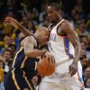 Oklahoma City\'s Serge Ibaka (9) defends Indiana\'s Dahntay Jones (1) during the NBA basketball game between the Oklahoma City Thunder and the Indiana Pacers at the Oklahoma City Arena, Wednesday, March 2, 2011. Photo by Bryan Terry, The Oklahoman