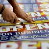 Photo - Tom Cushing, a production expert at Fast Signs, cuts down a sheet of anti-Senate Bill 1062 signs that read