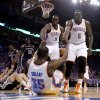 Oklahoma City\'s Serge Ibaka (9) and Kendrick Perkins (5) help up Oklahoma City\'s Kevin Durant (35) during game 7 of the NBA basketball Western Conference semifinals between the Memphis Grizzlies and the Oklahoma City Thunder at the OKC Arena in Oklahoma City, Sunday, May 15, 2011. Photo by Sarah Phipps, The Oklahoman