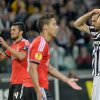 Photo - Juventus forward Fernando Llorente, right, touches his head during the Europa League semifinal second leg soccer match between Juventus and Benfica at the Juventus stadium, in Turin, Italy, Thursday, May 1, 2014. (AP Photo/ Massimo Pinca)