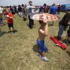 Jack Pitman, 11, of Oklahoma City, shades himself from the sun during a welcome home rally for the Oklahoma City Thunder at a field near Will Rogers Airport in Oklahoma City, Friday, June 22, 2012. Photo by Garett Fisbeck, The Oklahoman