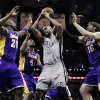 San Antonio Spurs\' Tim Duncan (21) grabs a rebound between Los Angeles Lakers\' Jodie Meeks (20), Antawn Jamison (4) and Pau Gasol (16) during the first half of Game 1 of their first-round NBA playoff basketball series, Sunday, April 21, 2013, in San Antonio. (AP Photo/Eric Gay)