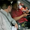 In this June 10, 2007 photo, Venezuela\'s President Hugo Chavez, right, speaks with AP reporter Ian James who sits in the passenger seat of a Toyota 4 Runner in San Fernando de Apure, Venezuela. During more than eight years covering Venezuela, James says he has gained more street smarts, become a tougher, more resourceful reporter and developed a deep affection for Venezuela, a country where events often collide in unpredictable and dramatic ways and where a wide gap frequently separates the reality on the street from the socialist-inspired dreams that Chavez has instilled in his followers. (AP Photo/Fernando Llano)