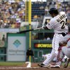 Photo - Pittsburgh Pirates' Pedro Alvarez (24) hits a three-run home run off St. Louis Cardinals starting pitcher Jake Westbrook (35) during the first inning of a baseball game in Pittsburgh, Monday, July 29, 2013. (AP Photo/Gene J. Puskar)