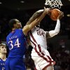 Oklahoma\'s Romero Osby (24) is fouled o a shot by Kansas\' Perry Ellis (34) during the second half as the University of Oklahoma Sooners (OU) defeat the Kansas Jayhawks (KU) 72-66 in NCAA, men\'s college basketball at The Lloyd Noble Center on Saturday, Feb. 9, 2013 in Norman, Okla. Photo by Steve Sisney, The Oklahoman
