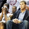 Photo - OU's Willie Warren, left, sits on the bench next to Blake Griffin after Warren fouled out on Monday against Kansas. Griffin's playing status remains unclear. BY NATE BILLINGS, THE OKLAHOMAN