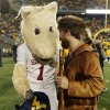 OU mascot Sooner and the West Virginia Mountaineer, Jonathan Kimble, talk before a college football game between the University of Oklahoma and West Virginia University on Mountaineer Field at Milan Puskar Stadium in Morgantown, W. Va., Nov. 17, 2012. Photo by Nate Billings, The Oklahoman