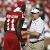 Oklahoma\'s Dorial Green-Beckham (11) walks past coach Bob Stoops before a college football game between the University of Oklahoma Sooners (OU) and the Louisiana Tech Bulldogs at Gaylord Family-Oklahoma Memorial Stadium in Norman, Okla., on Saturday, Aug. 30, 2014. Photo by Bryan Terry, The Oklahoman