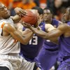 Photo - Oklahoma State's Markel Brown (22) fights for control with Kansas State's Angel Rodriguez (13), and Martavious Irving (3) during an NCAA college basketball game between the Oklahoma State University Cowboys (OSU) and the Kansas State University Wildcats (KSU) at Gallagher-Iba Arena in Stillwater, Okla., Saturday, Jan. 21, 2012. Photo by Bryan Terry, The Oklahoman
