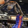 Photo -   Detroit Pistons forward Jason Maxiell, right, dunks over Sacramento Kings forward Jason Thompson during the first quarter of an NBA basketball game in Sacramento, Calif., Wednesday, Nov. 7, 2012. (AP Photo/Rich Pedroncelli)