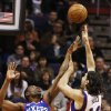 Phoenix Suns\' Luis Scola (14), of Argentina, shoots over Philadelphia 76ers\' Thaddeus Young (21) during the first half of an NBA basketball game, Wednesday, Jan. 2, 2013, in Phoenix. (AP Photo/Ross D. Franklin)