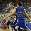 Arnett\'s Tyler Tune goes around Coyle\'s Ryan Weathers during the Class B boys state championship game between Coyle and Arnett in the State Fair Arena at State Fair Park in Oklahoma City, Saturday, March 2, 2013. Photo by Bryan Terry, The Oklahoman