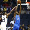 Memphis Grizzlies forward Rudy Gay (22) tries to block a dunk by Oklahoma City Thunder\'s Kevin Durant (35) during the first half of a preseason NBA basketball game Wednesday, Oct. 7, 2009, in Memphis, Tenn. (AP Photo/Lance Murphey) ORG XMIT: TNLM103