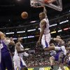 Los Angeles Clippers\' Caron Butler, center, dunks during the second half of an NBA basketball game against the Phoenix Suns in Los Angeles, Thursday, March 15, 2012. The Suns won 91-87. (AP Photo/Jae C. Hong)
