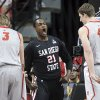 San Diego State\'s Jamaal Franklin, center, reacts after dunking during the first half of a Mountain West Conference tournament NCAA college basketball game against New Mexico on Friday, March 15, 2013, in Las Vegas. (AP Photo/Isaac Brekken) ORG XMIT: NVIB102