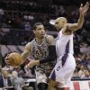 Photo - San Antonio Spurs' Danny Green (4) drives around Charlotte Bobcats' Gerald Henderson (9) during the first half of an NBA basketball game, Friday, Feb. 28, 2014, in San Antonio. (AP Photo/Eric Gay)