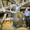 Bob Coriff, Edmond Electric Energy Services Manager, with the geothermal heat and air unit installed in the attic of an energy efficient home, 3716 Bonaire Place, in the Stonebridge Addition in Edmond Wednesday, March 4, 2009. BY PAUL B. SOUTHERLAND, THE OKLAHOMAN