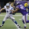 Photo - Detroit Lions quarterback Matthew Stafford, left, is sacked by Minnesota Vikings defensive end Everson Griffen during the second half of an NFL football game, Sunday, Dec. 29, 2013, in Minneapolis. The Vikings won 14-13. (AP Photo/Ann Heisenfelt)