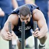 Photo - FILE - In this July 12, 2013, file photo, John Urschel pushes a weighted sled during the Penn State Football Lift for Life in State College, Pa. During an outstanding career at Penn State, Urschel was one of the most accomplished multitaskers in college sports. Academically, he was an even bigger star. (AP Photo/Centre Daily Times, Abby Drey, File) MAGS OUT  MANDATORY CREDIT