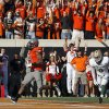 Oklahoma State\'s Joseph Randle (1) scores a touchdown in front of Baylor\'s Chance Casey (9) during a college football game between the Oklahoma State University Cowboys (OSU) and the Baylor University Bears (BU) at Boone Pickens Stadium in Stillwater, Okla., Saturday, Oct. 29, 2011. Photo by Sarah Phipps, The Oklahoman