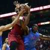 Photo - Oklahoma City Thunder'S Thabo Sefolosha (2) and Kendrick Perkins (5) defend Miami Heat's Chris Bosh (1) during the first half of an NBA basketball game, Tuesday, Dec. 25, 2012, in Miami. (AP Photo/J Pat Carter)