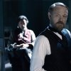 In this film image released by Warner Bros. Pictures, Robert Downey Jr., left, and Jared Harris are shown in a scene from