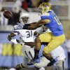 UCLA wide receiver Devin Lucien, right, fails to make a catch while defended by Nevada defensive back Randy Uzoma, left, and defensive back Alex Mackleft during the first half of an NCAA college football game in Pasadena, Calif., Saturday, Aug. 31, 2013. (AP Photo/Chris Carlson)
