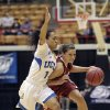 Oklahoma\'s Morgan Hook, right, tries to dribble past UCLA\'s Mariah Williams during the second half of a second-round game in the women\'s NCAA college basketball tournament Monday, March 25, 2013, in Columbus, Ohio. Oklahoma beat UCLA 85-72. (AP Photo/Jay LaPrete) ORG XMIT: OHJL110