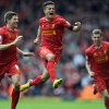 Photo - Liverpool's Philippe Coutinho, centre, celebrates with teammate Steven Gerrard, left, after he scored the third goal of the game for his side during their English Premier League soccer match against Manchester City at Anfield in Liverpool, England, Sunday April. 13, 2014. (AP Photo/Clint Hughes)