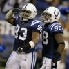Photo -   FILE - In this file photo taken Nov. 27, 2011, Indianapolis Colts defensive ends Dwight Freeney, left, and Robert Mathis celebrate a sack during the second quarter of an NFL football game against the Carolina Panthers in Indianapolis. Freeney and Mathis, one of the leagues most feared pass-rushing tandems for nearly a decade in Indy's traditional 4-3 defense, are now considered linebackers in coach Pagano' s preferred 3-4 hybrid defense. (AP Photo/Darron Cummings, file)