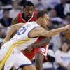 Photo - Golden State Warriors' Stephen Curry (30) dribbles around Los Angeles Clippers' DeAndre Jordan during the first half of an NBA basketball game in Oakland, Calif., Wednesday, Jan. 2, 2013. (AP Photo/Marcio Jose Sanchez)