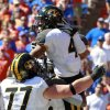 Missouri running back Kendial Lawrence (4) celebrates with teammates including offensive linesman Evan Boehm (77) after scoring a touchdown on a 1-yard run against Florida during the first half of an NCAA college football game, Saturday, Nov. 3, 2012, in Gainesville, Fla. (AP Photo/John Raoux)