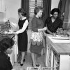 FILE - In this March 1963 file photo, black and white students participate in a home economics class at West Virginia State College at Institute, W.Va. From left are: Carolyn Walker, Mae Alice Ervin, Donna Long and instructor Alberta Witherspoon. The school, one of a number in which reverse integration is taking place, has changed from a predominantly African-American college to one with 65-to-70 per cent white students in its student body of 2,502. (AP Photo/File)