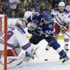 Tampa Bay Lightning center Dana Tyrell (42) loses control of the puck in front of New York Rangers goalie Martin Biron (43) during the second period of an NHL hockey game on Saturday, Feb. 2, 2013, in Tampa, Fla. Rangers\' Brad Richards, right, trails the play. (AP Photo/Chris O\'Meara)