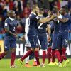 Photo - France's Karim Benzema, center, is congratulated by France's Blaise Matuidi (14), Rio Mavuba (12) and other teammates after their 3-0 victory over Honduras during the group E World Cup soccer match between France and Honduras at the Estadio Beira-Rio in Porto Alegre, Brazil, Sunday, June 15, 2014.(AP Photo/Fernando Vergara)