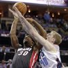 Photo - Miami Heat's Norris Cole (30) is fouled by Charlotte Bobcats' Cody Zeller (40) during the second half in Game 4 of an opening-round NBA basketball playoff series in Charlotte, N.C., Monday, April 28, 2014. The Heat won 109-98, sweeping the series. (AP Photo/Chuck Burton)