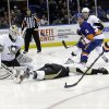 Photo - Pittsburgh Penguins goalie Jeff Zatkoff (37) stops a shot on goal by New York Islanders' Peter Regin (16) during the second period of an NHL hockey game, Thursday, Jan. 23, 2014, in Uniondale, N.Y. (AP Photo/Frank Franklin II)