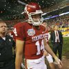 Oklahoma\'s Sam Bradford walks off the field after the BCS National Championship college football game between the University of Oklahoma Sooners (OU) and the University of Florida Gators (UF) on Thursday, Jan. 8, 2009, at Dolphin Stadium in Miami Gardens, Fla. Oklahoma lost the game 24-14 to the Gators. PHOTO BY CHRIS LANDSBERGER, THE OKLAHOMAN