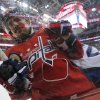Photo - Washington Capitals center Marcus Johansson (90), from Sweden, is knocked against the boards by Winnipeg Jets right wing Blake Wheeler during the first period of an NHL hockey game, Thursday, Feb. 6, 2014, in Washington. (AP Photo/Alex Brandon)