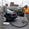 New York National Guard personnel pump gas into a vehicle as up to ten gallons of free gas is given away in the Jamaica neighborhood of the Queens borough of New York, Saturday, Nov. 3, 2012, in the wake of Superstorm Sandy. Trucks are being provided by the U.S. Department of Defense at the direction of President Barack Obama and are being deployed in coordination with the New York National Guard at the direction of the governor. (AP Photo/Craig Ruttle)