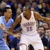 Oklahoma City \'s Kevin Durant (35) tries to get by Los Angeles\' Matt Barnes (22) during the NBA game between the Oklahoma City Thunder and the Los Angeles Clippers at the Chesapeake Energy Arena, Sunday, Feb. 23, 2014. Photo by Sarah Phipps, The Oklahoman