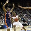 OU\'s Willie Warren drives around Morgan State\'s Ameer Ali during a first round game of the men\'s NCAA tournament between Oklahoma and Morgan State in Kansas City, Mo., Thursday, March 19, 2009. PHOTO BY BRYAN TERRY, THE OKLAHOMAN