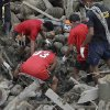 Rescuers work to retrieve another flash flood victim from the debris of Tuesday\'s Typhoon Bopha at New Bataan township, Compostela Valley in southern Philippines Friday Dec. 7, 2012. Rescuers were digging through mud and debris Friday to retrieve more bodies strewn across a farming valley in the southern Philippines by a powerful typhoon. (AP Photo/Bullit Marquez)